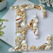Ký tự chữ đính vỏ sò ốc – E