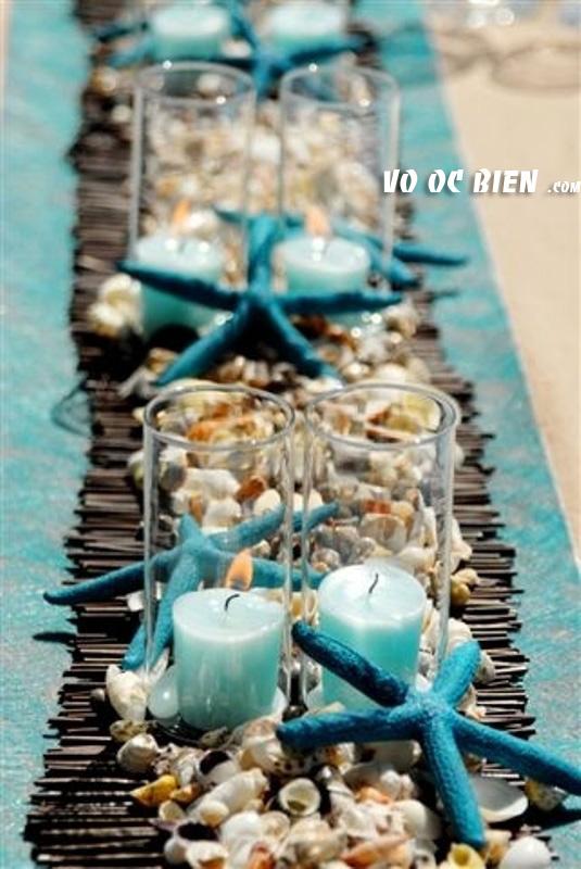 bàn tiệc đám cưới biển được sữ dụng tông màu xanh nhạt thật mát mẽ